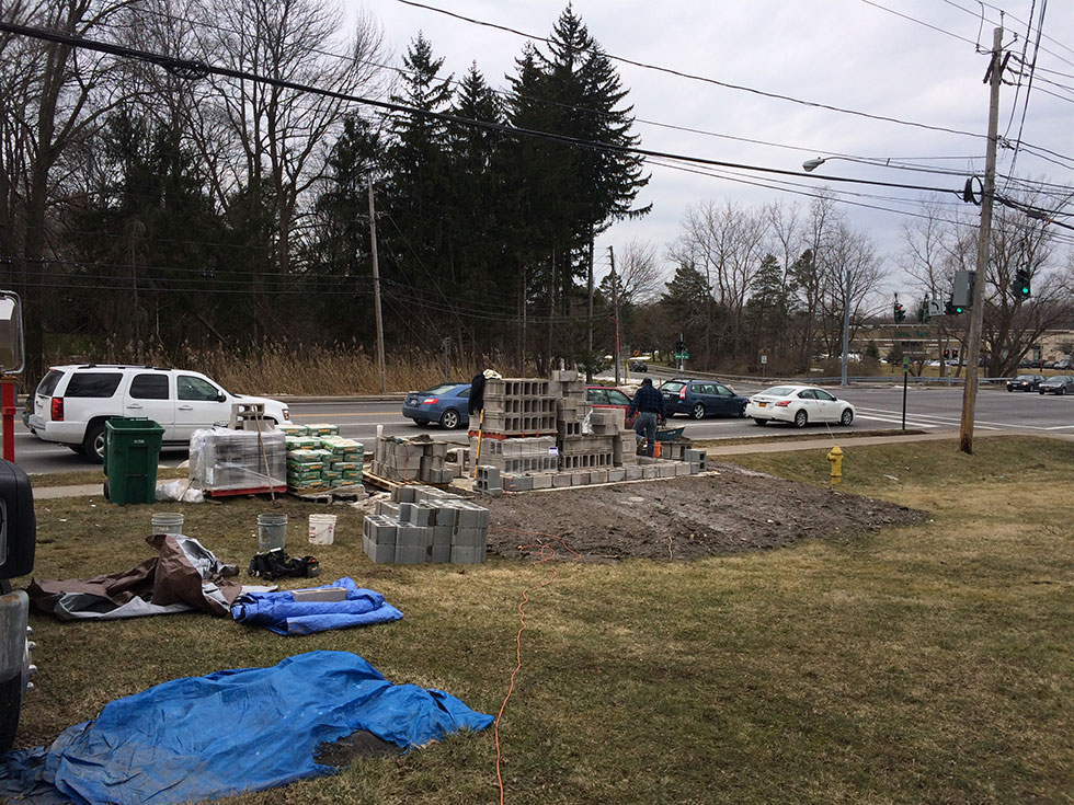 A new LEGO bus shelter is being constructed at the corner of Monroe Avenue and French Road in Pittsford. [IMAGE: Reconnect Rochester]