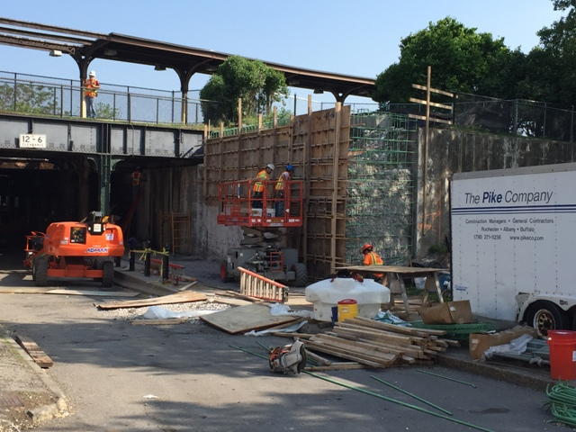 Carpenters form up the south east abutment of the railroad bridge over N. Clinton Ave to reface it. 5-22-15 [PHOTO: NYSDOT]