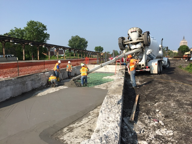 Placing concrete to fill in the Clinton Ave skylight #2. 6-23-15 [PHOTO: NYSDOT]