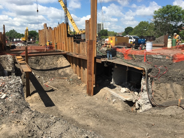 Sheeting and shoring continues in front of the 1914 passenger tunnel. Sheeting will allow for excavation to drive piles and construct the new platform. 6-26-15 [PHOTO: NYSDOT]