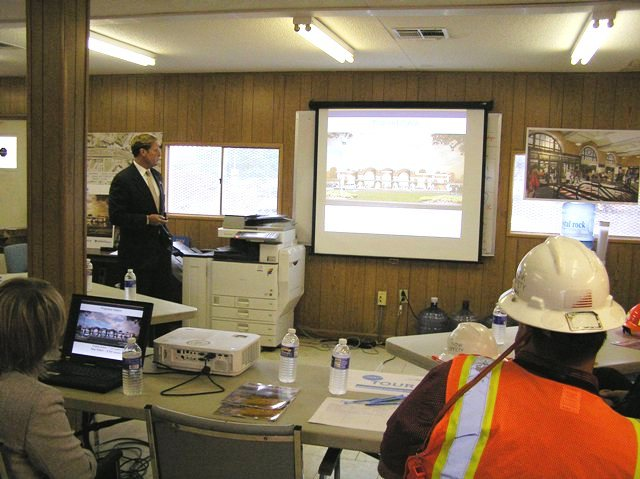 NYSDOT Commissioner addresses stakeholders in the project field office. 7-9-15 [PHOTO: NYSDOT]