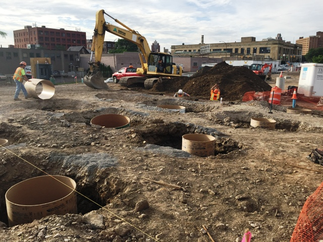 Form work for the foundation piers for the temporary station is underway. Looking southeast with post office in the background. 7-17-15 [PHOTO: NYSDOT]