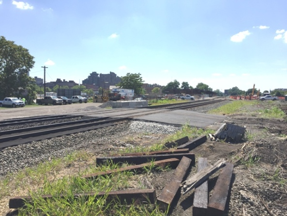 New track crossing installed by CSX contractor to the East of the existing crossing. Existing track crossing in background. 7-28-15 [PHOTO: NYSDOT]