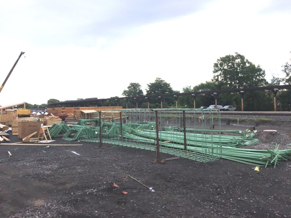 Rebar delivery and cage preparation to be placed within platform formwork. 8-3-15 [PHOTO: NYSDOT]